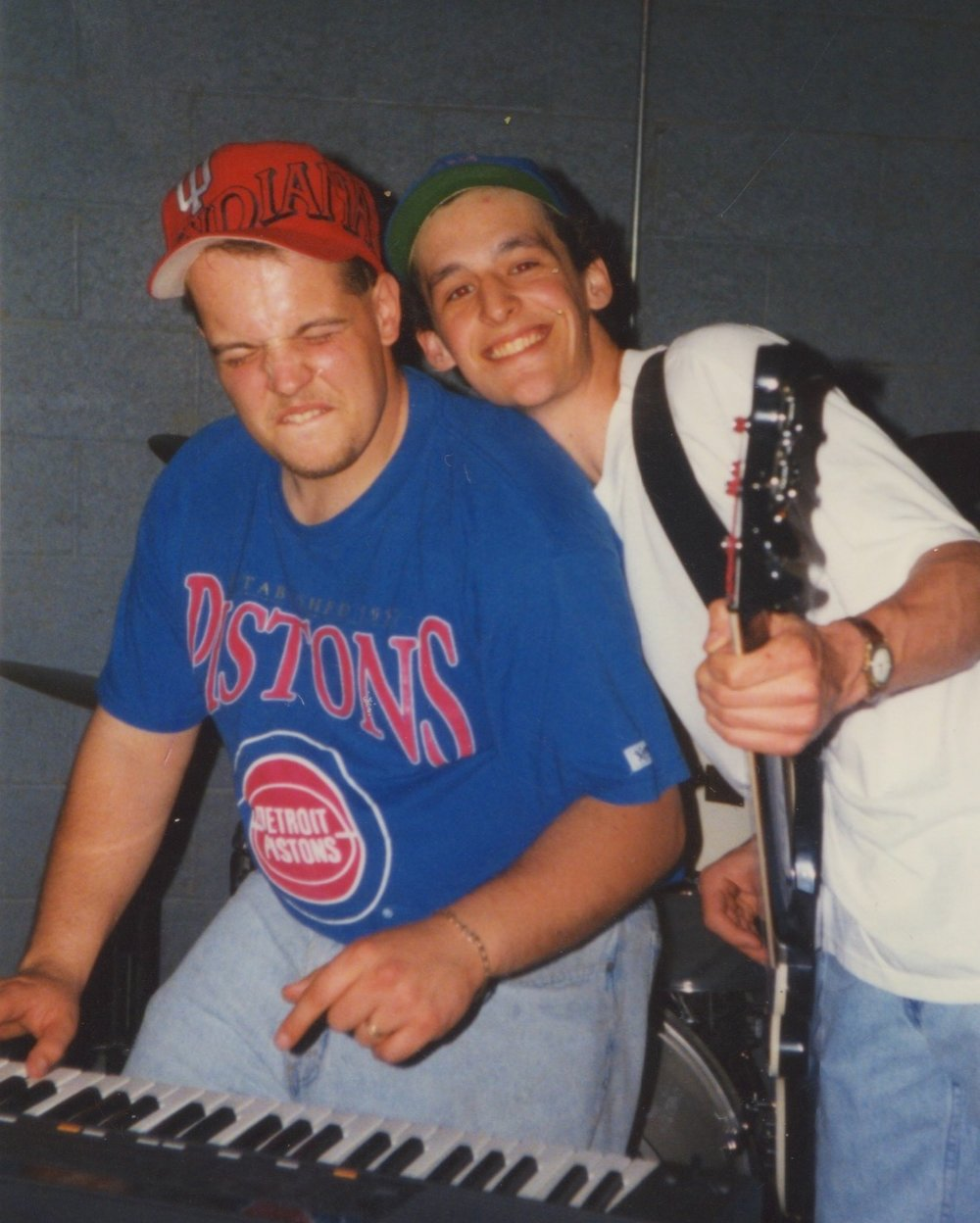 Justin and Eric in 1996. Eric is the one smiling, while Justin drops the hammer on a Bb.