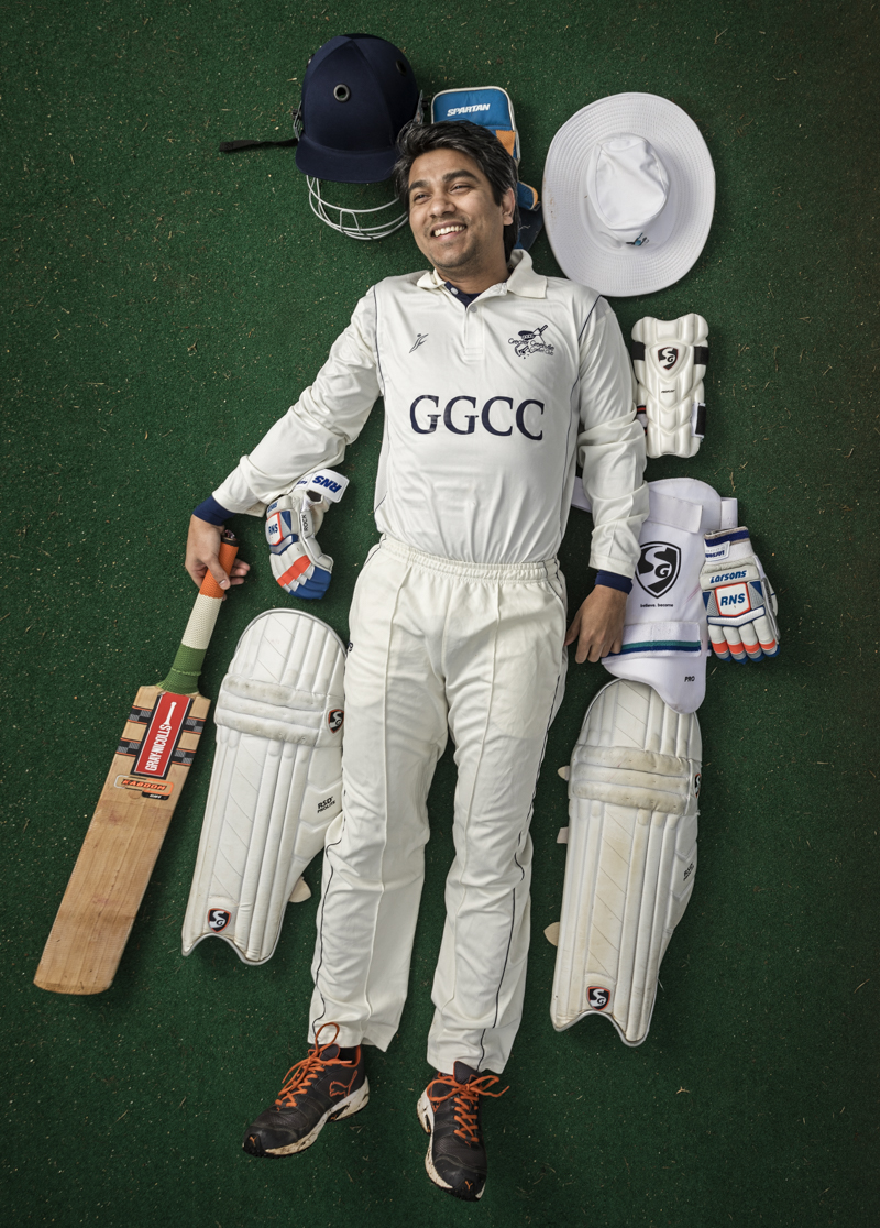 Kamal with the cricket equipment on the pitch