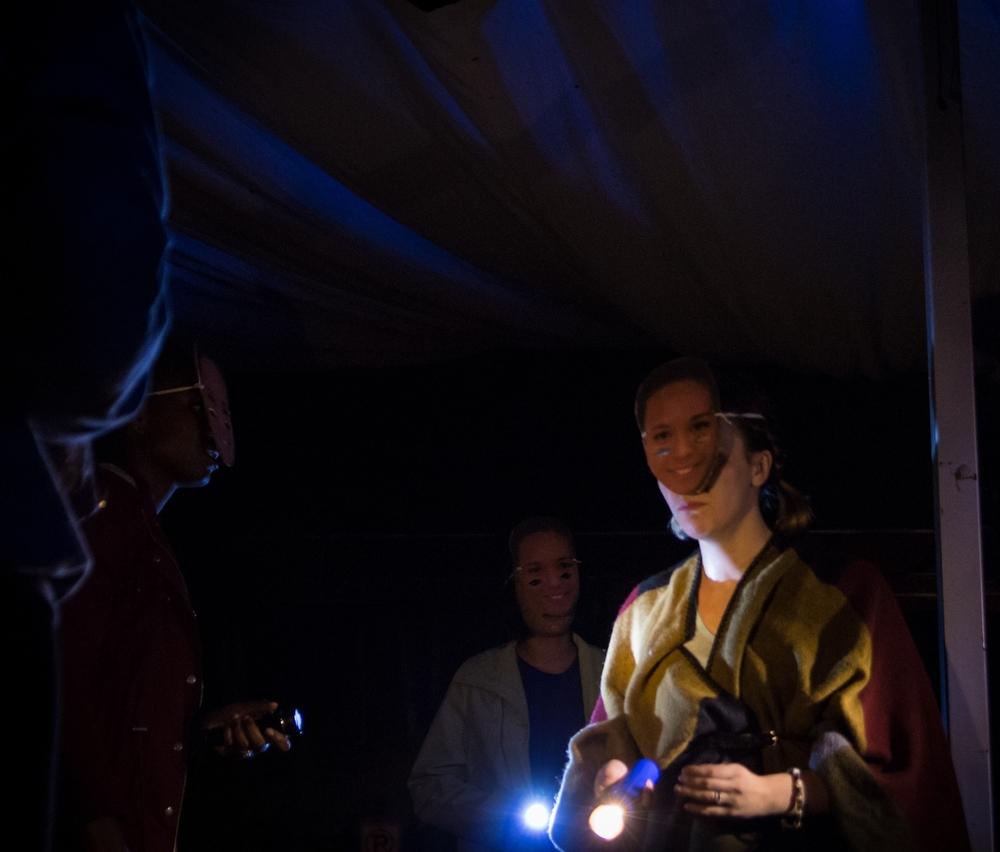 Four (Anique Mercier) leading her friends into the woods for a seance.  Photo courtesy of Aidan L. Marshall.