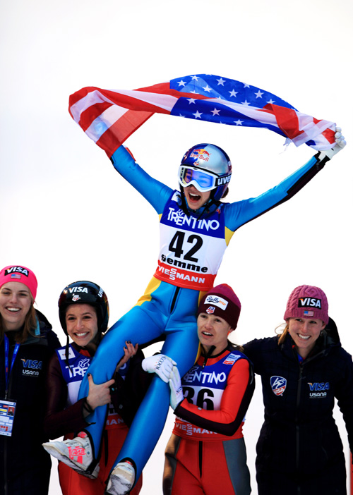 Sarah Hendrickson celebrates with teammates Abby Hughes, Jessica Jerome, Lindsey Van, and Abby Hughes. Photo by Sarah Brunson/US Ski Team