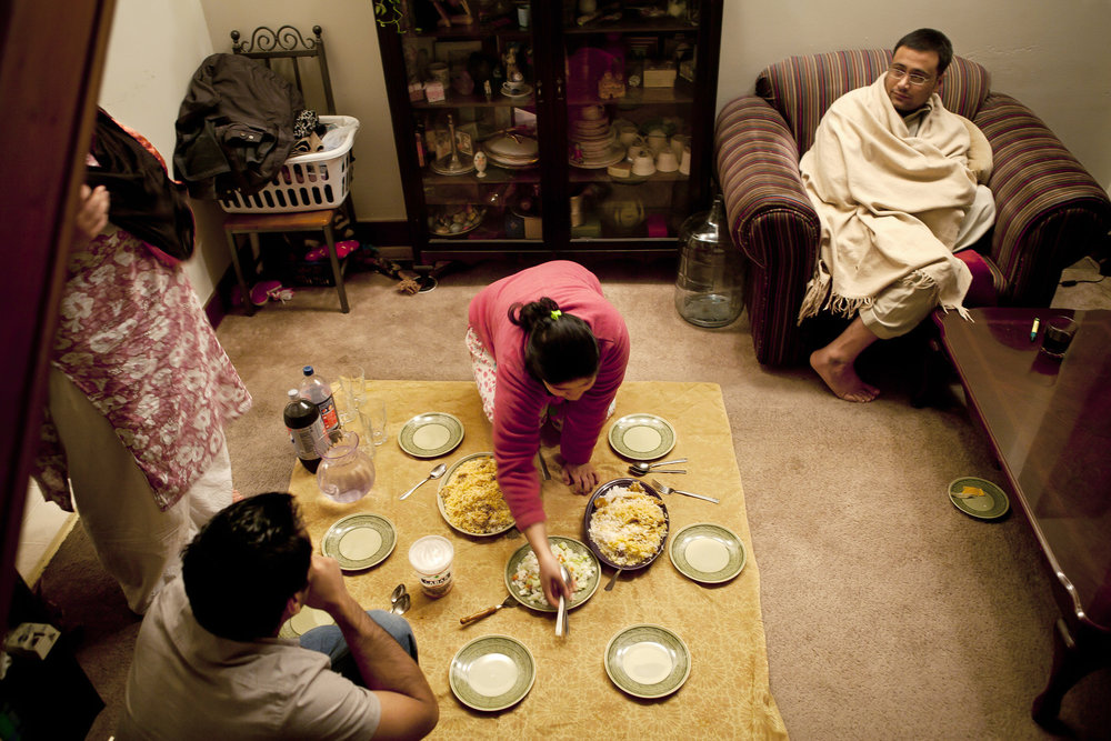 Since their apartment is so small, the family does not have the space for a dining room table. Most nights they eat on the floor. Aasma lays out two different versions of biryani, including one specifically prepared for Amie that is less spicy.