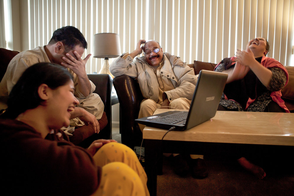 Despite the 10 hour time difference between Cleveland and Karachi, the family skypes almost daily. The scene on the computer screen is taking place thousands of miles away where Yasir's wife Miriam is currently living with her mother-in-law. Miriam holds up Yasir's eight-month-old son, Rahid, who Yasir, second from left, has never met in person.