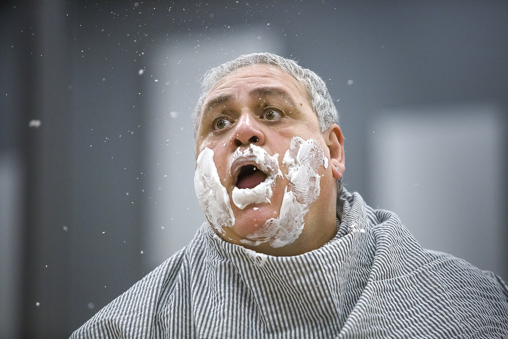 Dr. Bartolo spits shaving cream after a shave from Figaro. Bruno Pratico, who plays the role of Dr. Bartolo, has won numerous awards including the Rossini d'oro prize for his work in Rossini's operas.