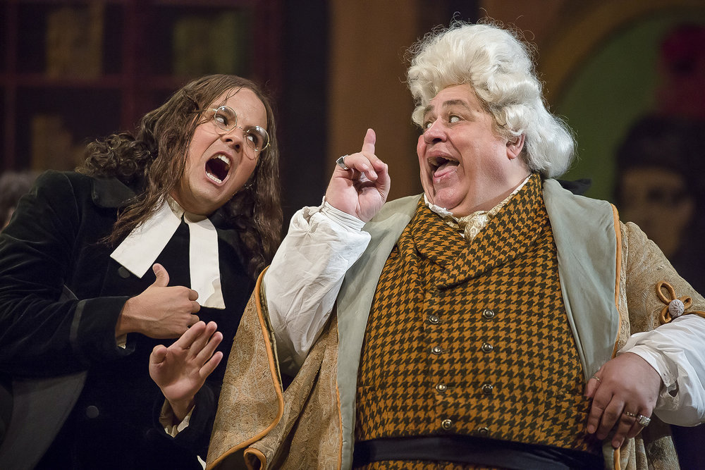 "Count Almaviva, left, and Dr. Bartolo, right, confront each other while the count is disguised as a music teacher in order to spend time with Rosina. David Portillo, who plays Count Almaviva, enjoys the role because he gets to spend the entire evening plotting with Figaro. ""The exciting part of playing the Count usually has to do with getting caught but knowing you're immune to punishment because of your nobility. It makes it easy to play and have fun rather than sulk about concerned with losing the one you love."""
