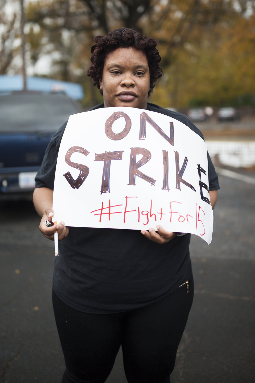 Nikita Alston arrives at a Fight for 15 minimum wage rally in Durham.