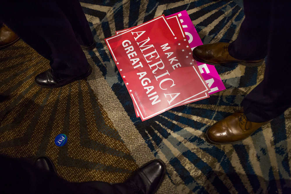 Trump signs lay on the floor at a Republican election watch party in Raleigh.
