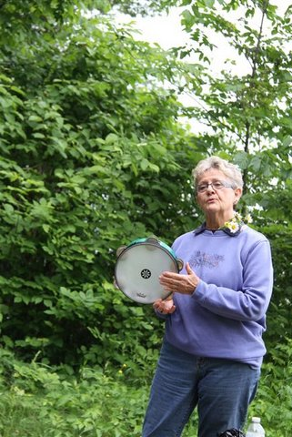 Outdoors, a frame drum with jingles invokes a prayer time for Sylvia.