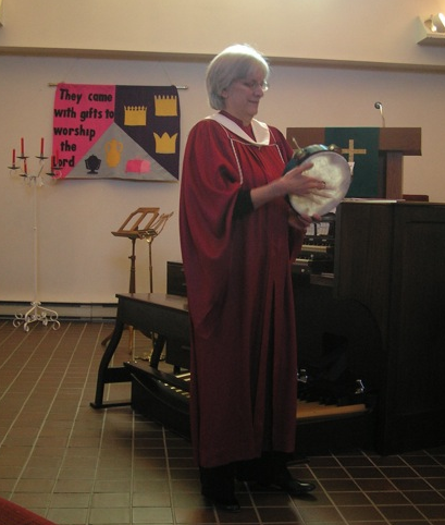Sally Duke drums in worship at Kanata United Church