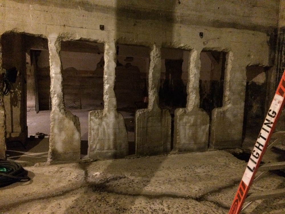 """""""this corner was too creepy not to use,"""" the guide said, speaking about an area of the Armory where Mission Dolores creek bubbles up from underground, creating a dank atmosphere."""