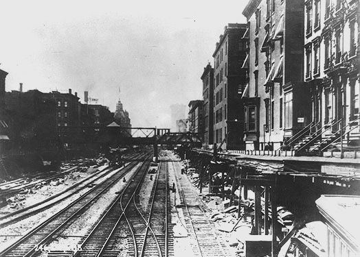 Exposed railroad tracks along Fourth Avenue, now Park Avenue, leading to the old Grand Central Depot, circa 1898.  Courtesy beautyofnyc.org.