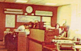 "A section of the WOR Radio newsroom as it appeared  in 1979.  The editor's desk is the large ""box"" in the center.  At right, behind the manual typewriter, is editor Jim Yoell.   Courtesy New York Radio News."