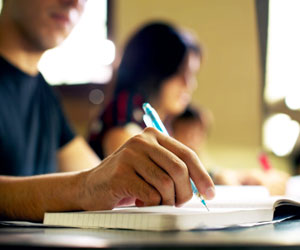 Ditch the laptop and pick up a writing implement for comprehension, a new study finds. Courtesy the Association for Psychological Science.