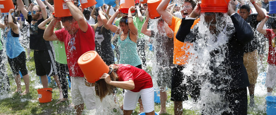 Boston City Councillor Tito Jackson, right, leads some 200 people in the ice bucket challenge at Boston's Copley Square, Thursday, Aug. 7, 2014 to raise funds and awareness for ALS. Courtesy The Associated Press.