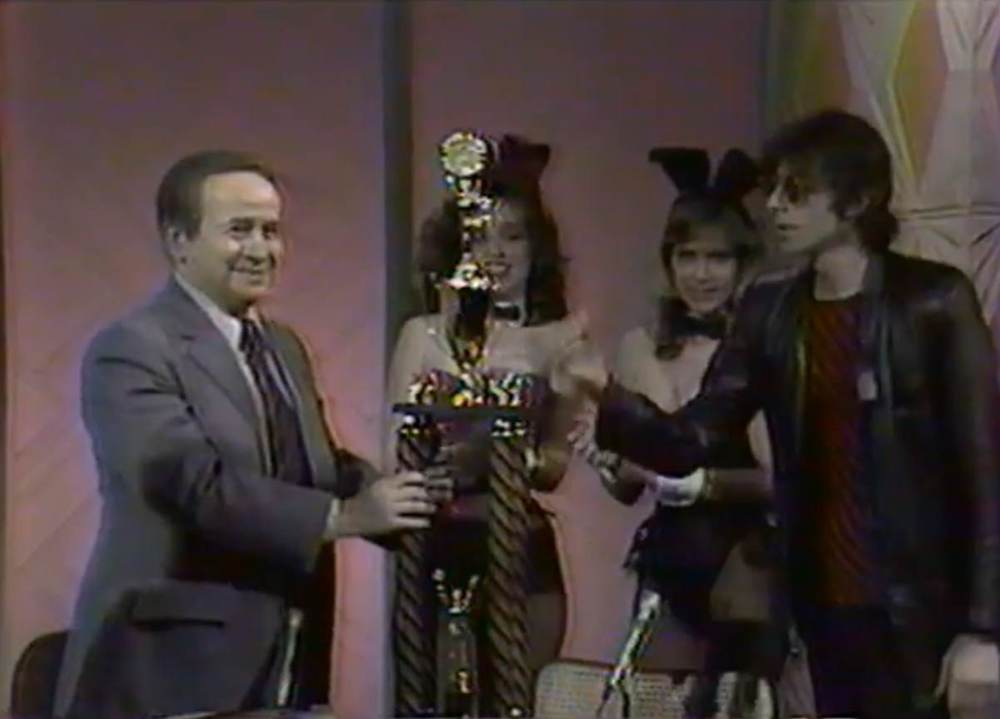 Franklin receiving a tribute from musician J. Geils and two Playboy bunnies after singing his band's hit record, Centerfold, on the Joe Franklin Show in 1982.   Image from a video posted on YouTube.