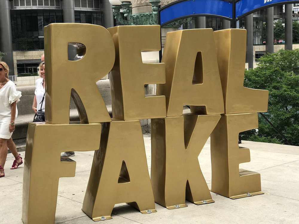 """Real Fake"" street art installation at Wacker Drive and Wabash Avenue, Chicago. Image courtesy  Wikimedia Commons ."
