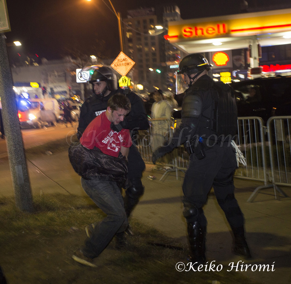 October 30 2013, Boston, MA USA; Mass State Police in riot gear arrested a fan during the celebration of the Boston Red Sox defeating the St. Louis Cardinals to win the World Series just outside Fenway Park in Boston, MA.