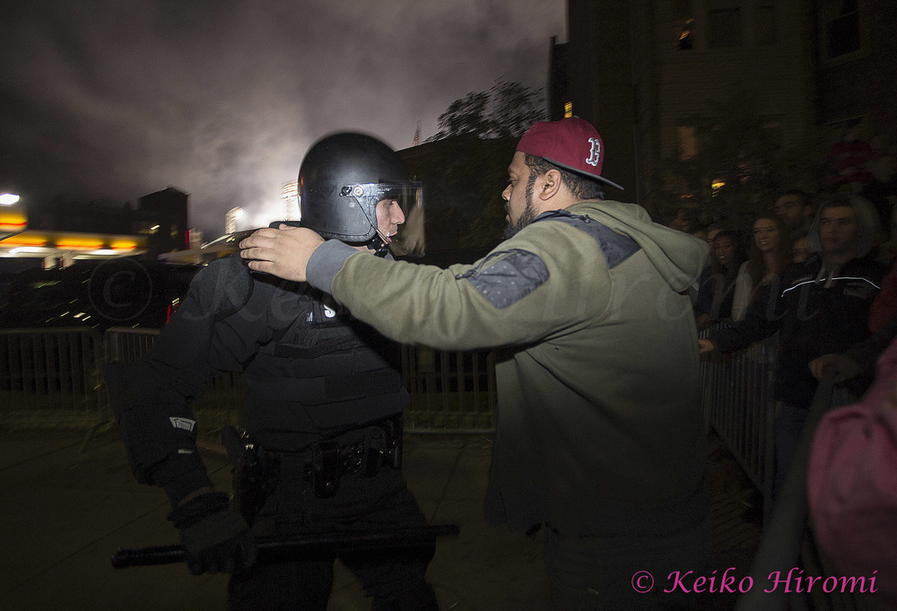 October 30 2013, Boston, MA USA; Mass State Police in riot gear move the crowd from around Fenway Park as fans celebrate the Boston Red Sox defeating the St. Louis Cardinals to win the World Series just outside Fenway Park in Boston, MA