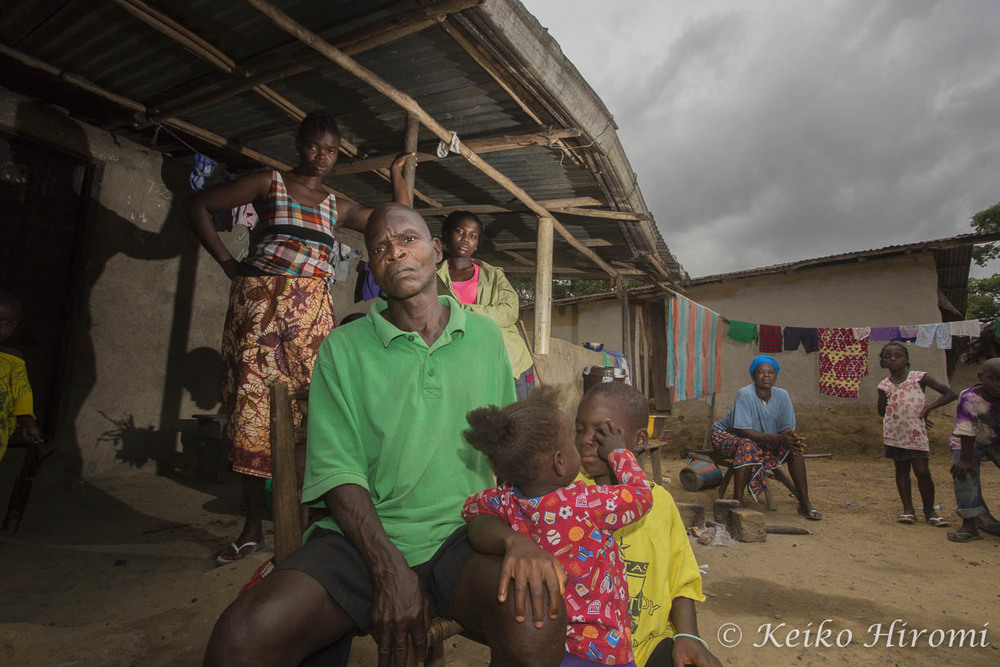 Ebola Survivor Anthony Paye (green shirt) with his surviving family