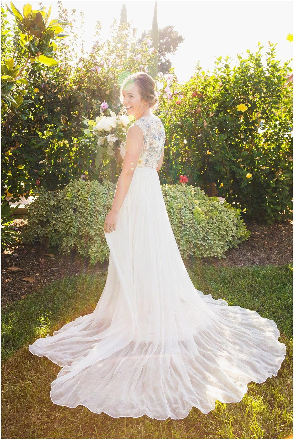 orange county wedding photographer__0009 bride in blue beaded wedding gown from behind.jpg