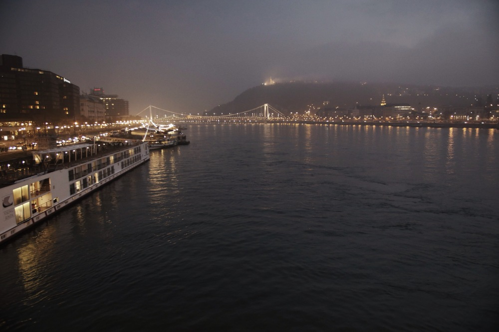 View of the Danube on an early winter night while a eerie fog set in