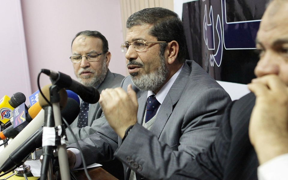 Mohamed Morsi, center, speaks to the press alongside other Muslim Brotherhood leaders days after escaping from prison during the 2011 uprising in Egypt, before his election to and ouster from the presidency.  (Khaled Elfiqi/EPA)