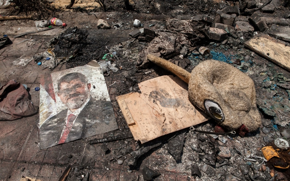 A poster of deposed Egyptian President Mohammed Morsi lies in the debris on August 15, 2013 in Cairo, Egypt. ( Ed Giles/Getty Images)