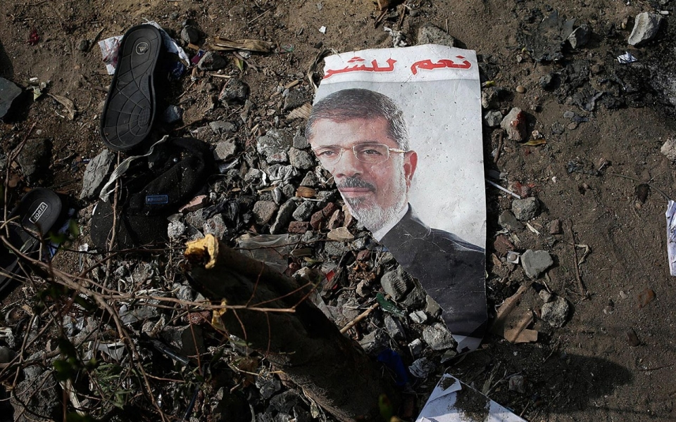 A trampled poster of Egypt's ousted president Mohamed Morsi on the ground outside the Rabaah al-Adawiya Mosque in Cairo, Aug. 16, 2013. ( Hassan Ammar/AP Photo)