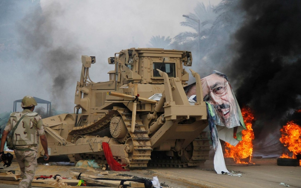 A poster of deposed Egyptian President Mohamed Morsi lies on a bulldozer in Giza, south of Cairo, as the Egyptian military cleared a pro-Morsi sit-in. August 14, 2013.
