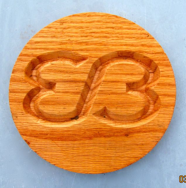 A V-Carved logo in Oak