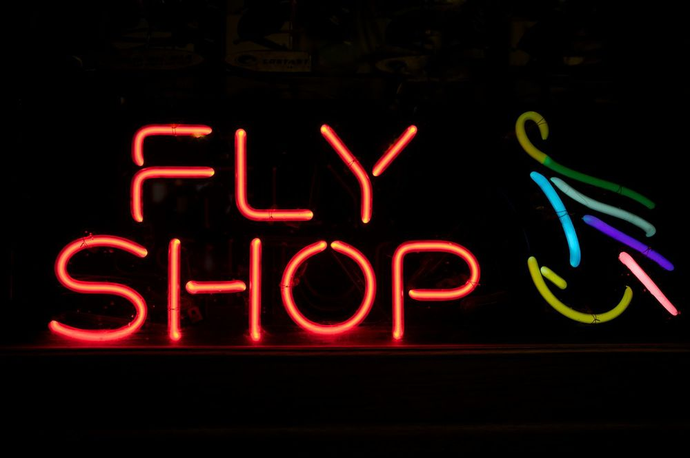 "Neon ""fly shop"" sign"