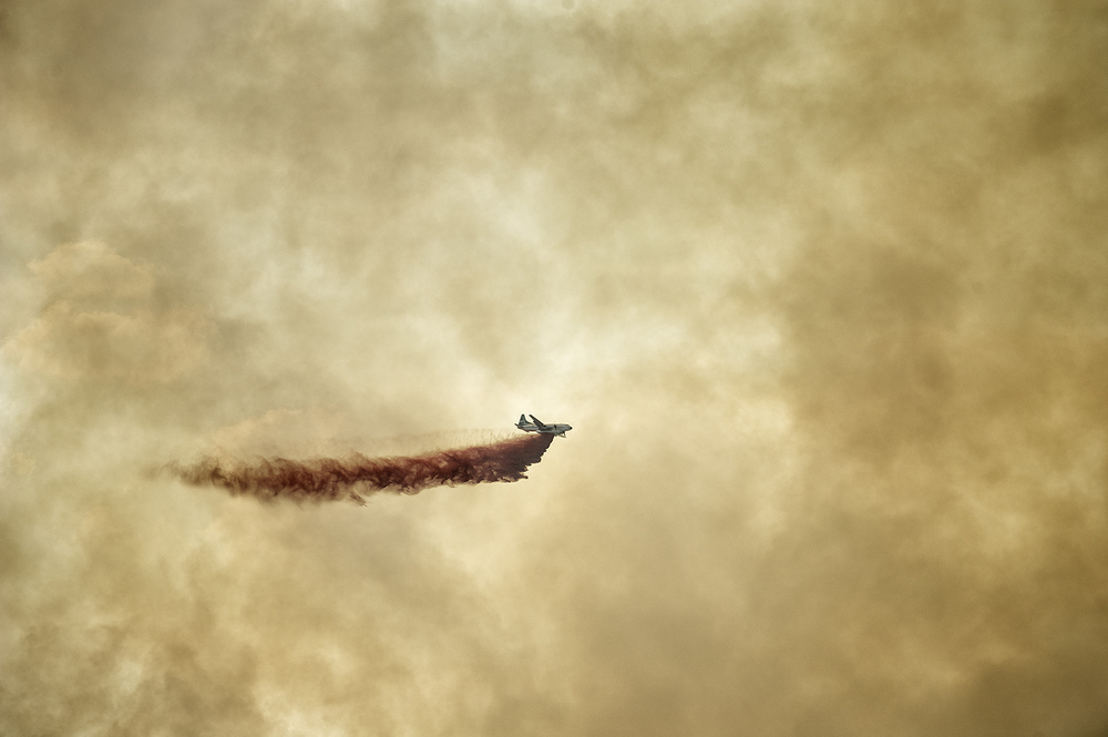 A retardant bomber unleashes near Sun Valley, Idaho.