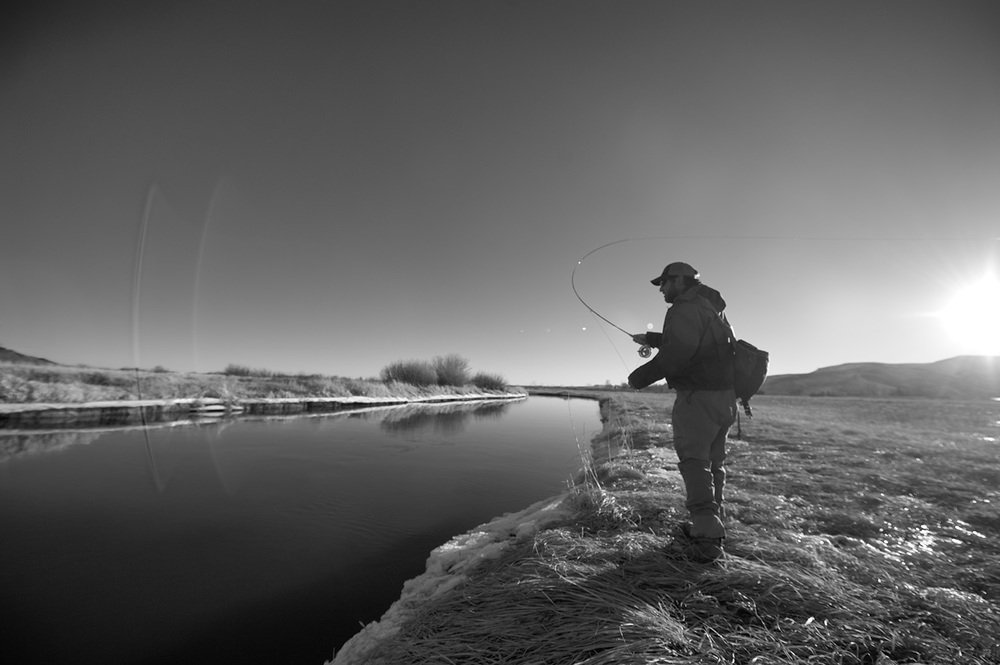 John Huber making a January cast. Silver Creek, Idaho.