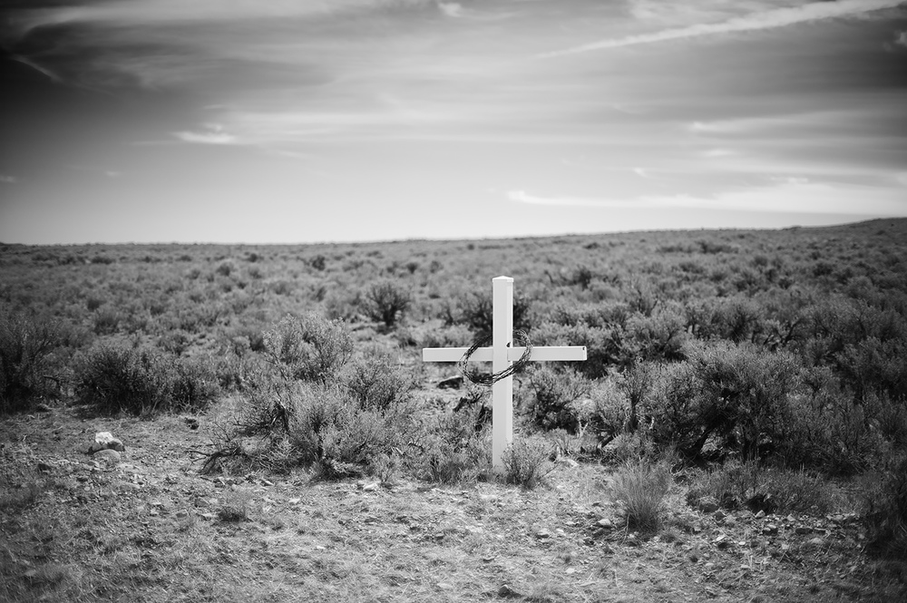 Cross near dirt road. Arco, Idaho.