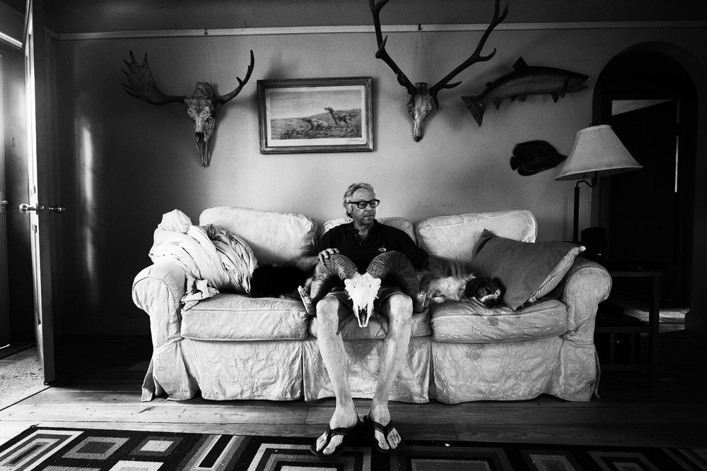 "Dan Lahren. ""Dangerous Dan."" Livingston, MT August 2017. Dan was Jim Harrison's guide for many years and even guided Harrison as many as 70 days in a single season. Dan is pictured in his living room."