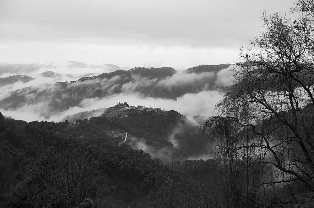 tuscan hills town clouds bw.jpg