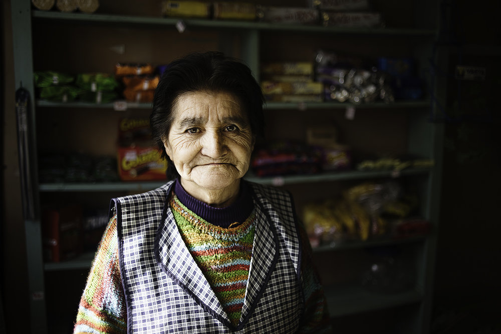 Woman in a small village store. Villa Nirehau, Chile.