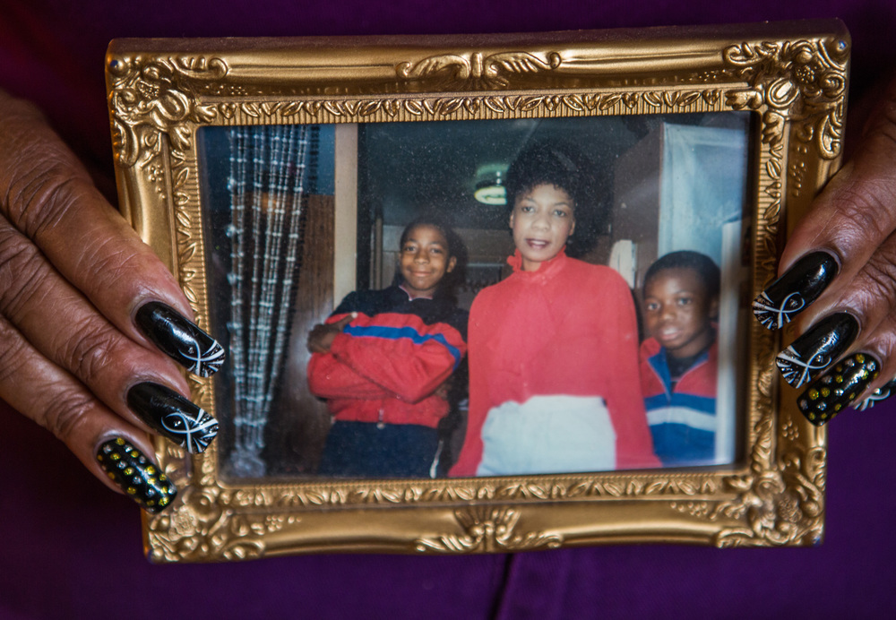 Gwenn Carr, mother to Eric Garner, whose death at the hands of the NYPD drew national attention and ignited public protest against police brutality, holds a photo of Eric and his siblings in her home in Staten Island, New York, for  Women in the World .