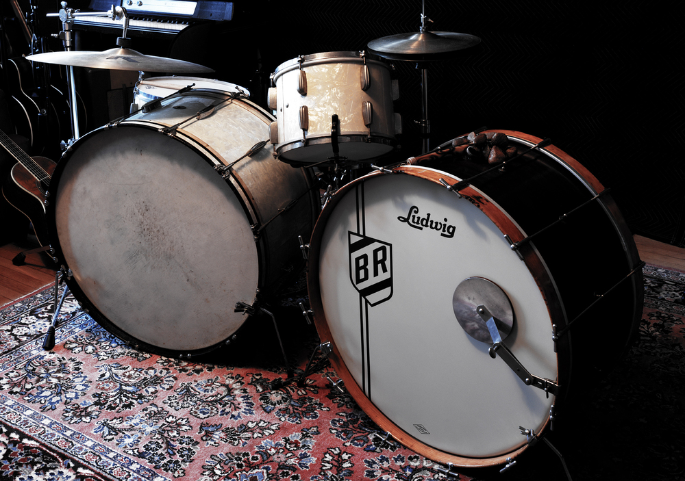 "1930's/40's Slingerland Radio King drums (left) and 1920""s Ludwig bass drum (right)"