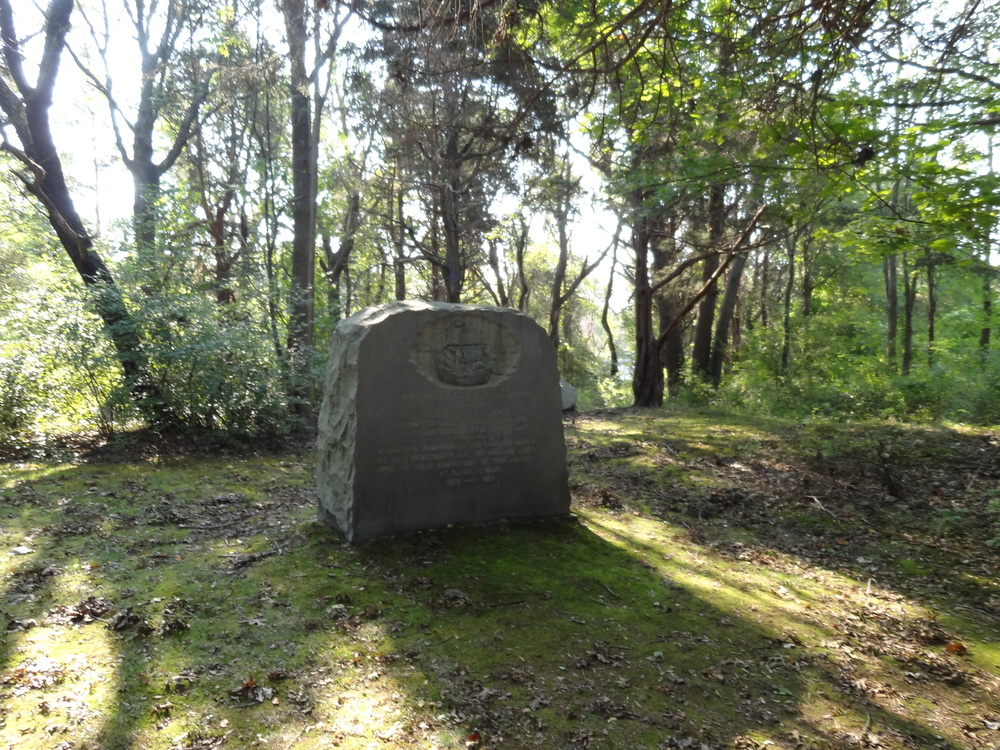 Stone memorial marking the spot of John and Elizabeth (Tilley) Howland's homesite in Rocky Nook, north of Plymouth.  The Pilgrim John Howland society owns the land and archaeologists have worked the site each summer for a number of years.