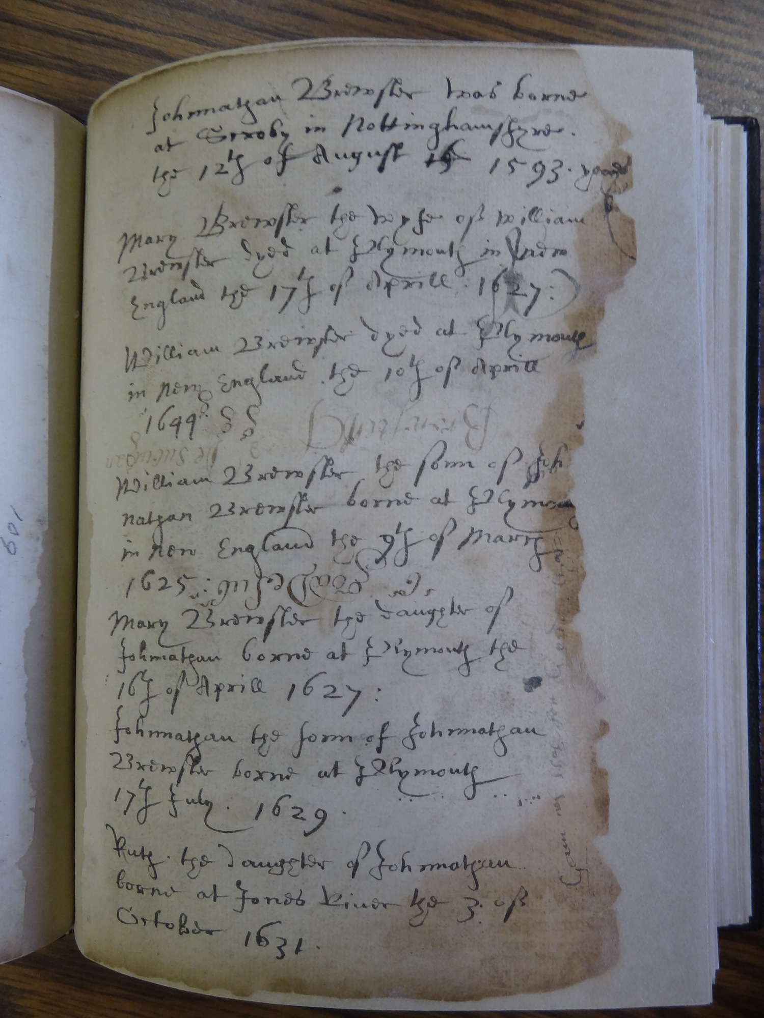 "A page from the ""Brewster Book,"" containing some of the family birth and death records for William and Mary Brewster and their children."
