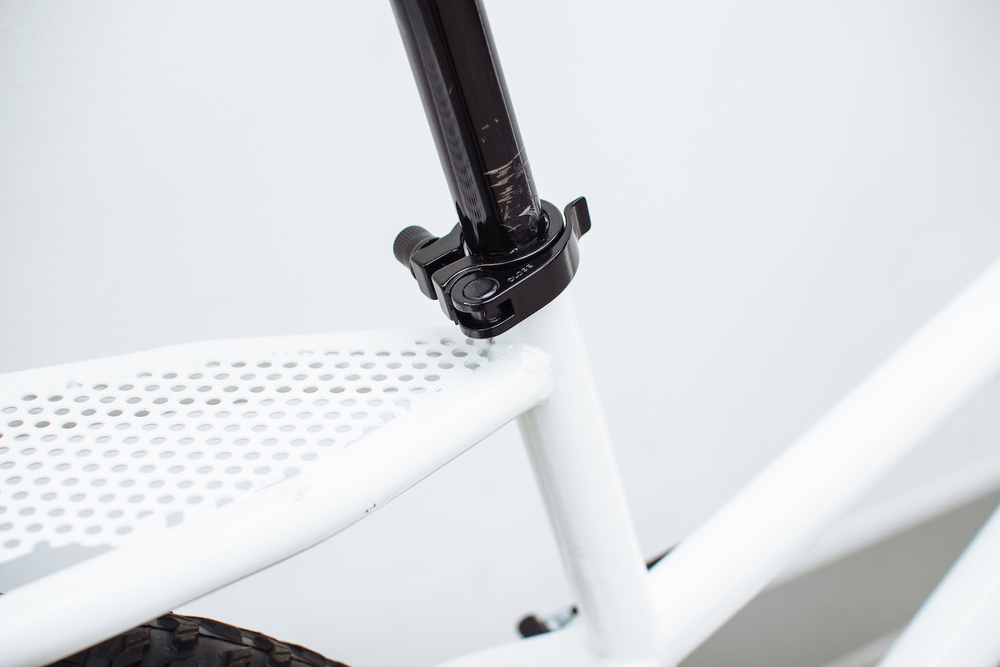 A quick release seatpost allows young kids and adults to use the bike
