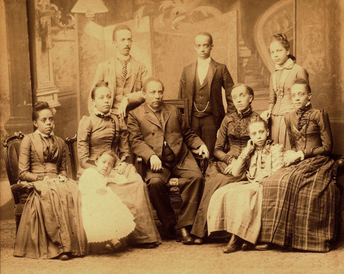 Tanner (standing, left) and his family.