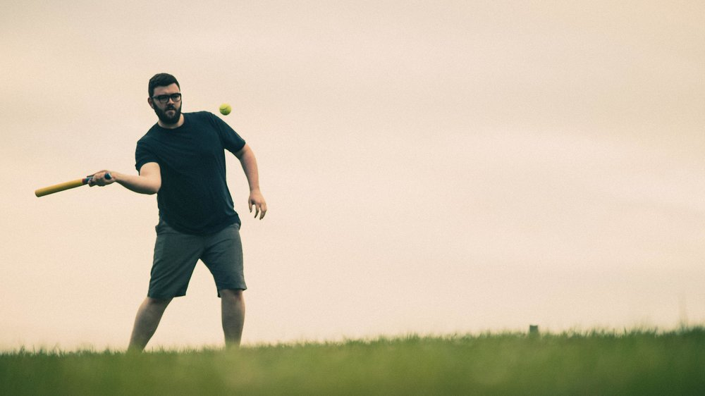 Guy playing rounders