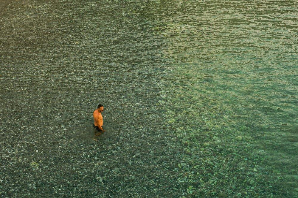 Man swimming in Loutro, Crete