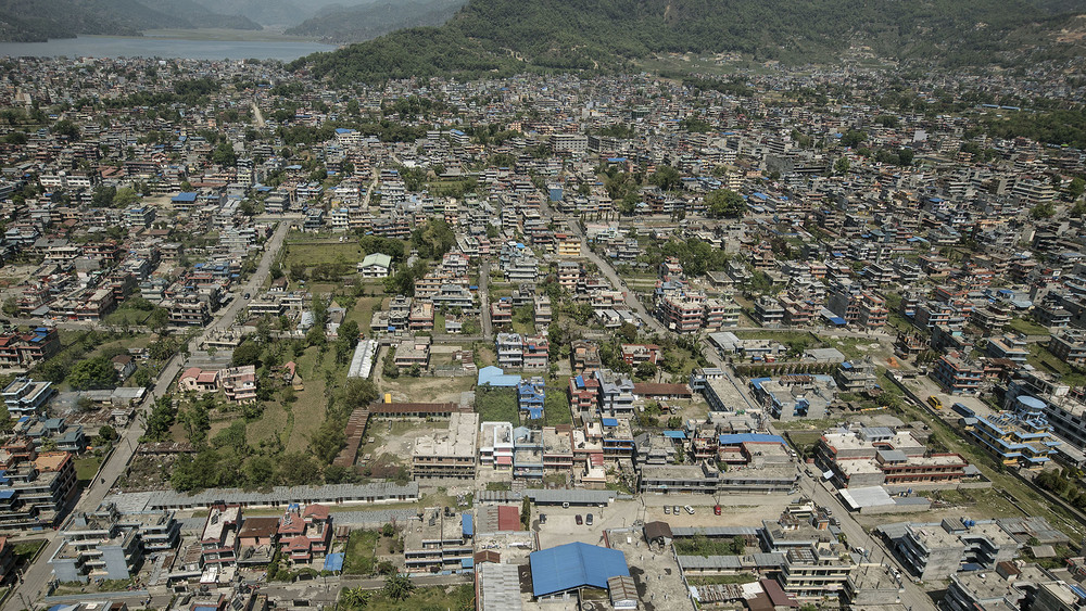 The city of Pokhara continues to develop and expand, accommodating the growing number of tourists who flock to western Nepal, primarily for trekking in the Annapurna region.  Phewa lake pictured in the background.