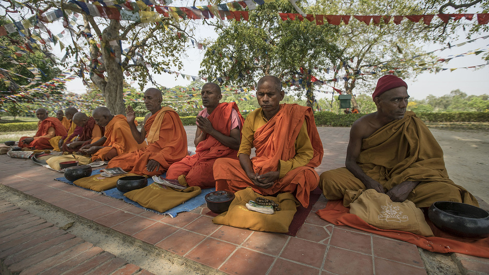 Holy men at the birthplace of the Buddha, Lumbini, Nepal.
