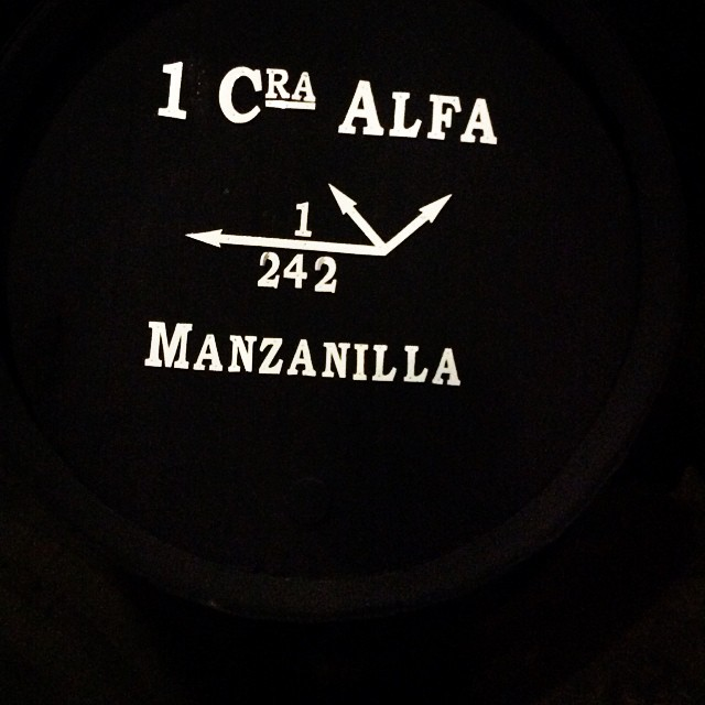 Signs on a barrel of manzanilla in a dark Bodega San Luís (La Gitana). Copyright: Cruz Liljegren
