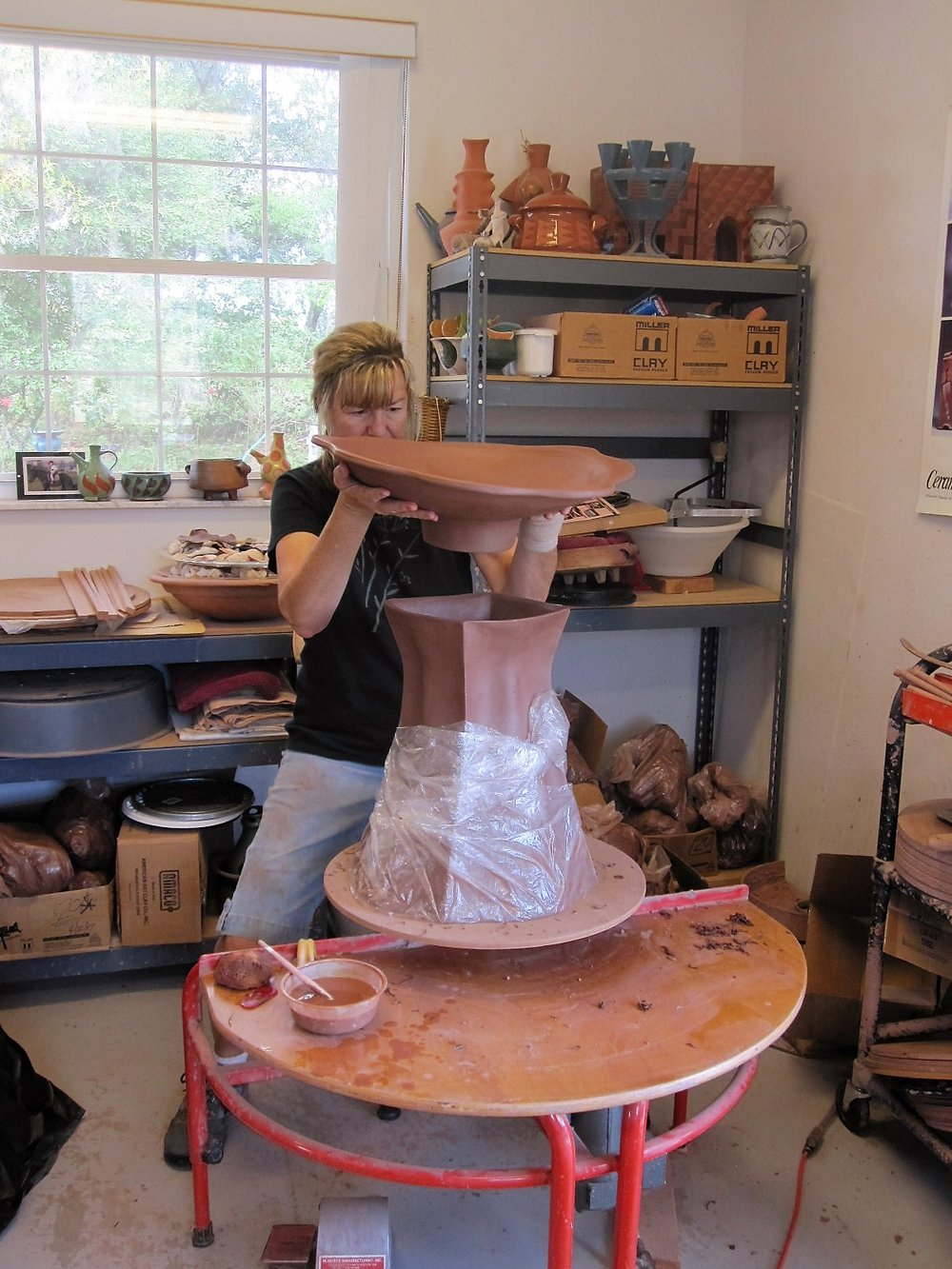 Michele Ginouves adding bowl to birdbath.JPG