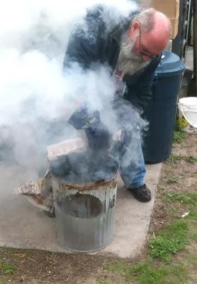 Kellum John Raku firing pots2.jpg
