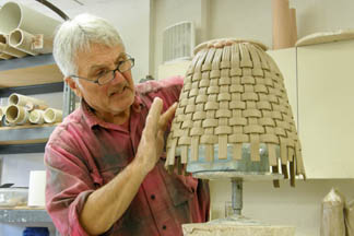 Jim parmentier working in clay low res.jpg